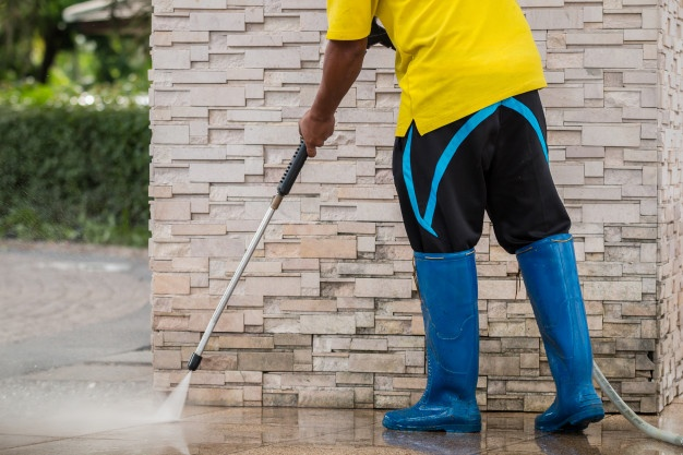 outdoor-floor-cleaning-with-high-pressure-water-jet_30478-1977